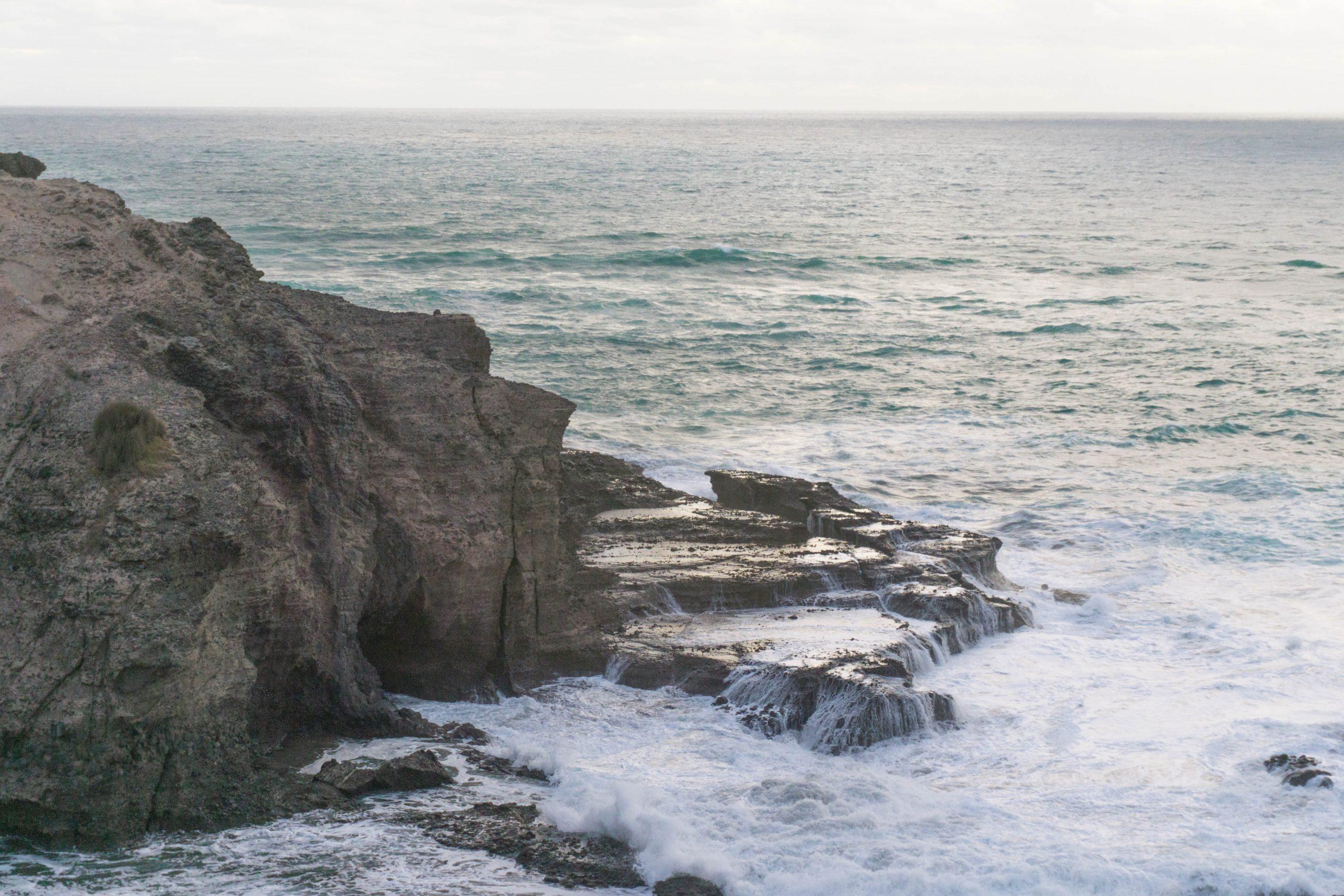 Waves crashing on the rock at Piha beach